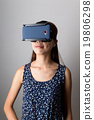Young woman wearing VR-headset with smart phone 19806298