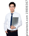 Businessman hold with notebook computer 19806367
