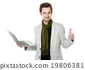 Man use of laptop and thumb up 19806381