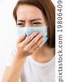 Woman feeling unwell 19806409