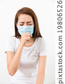 Woman cough though medical face mask 19806526