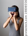 Woman feeling shocking when using the vr device 19806556
