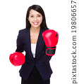 Asian businesswoman with boxing gloves for cheerup gesture 19806657