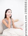 Woman doing the skincare treatment 19806681