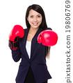 Business woman boxing punching towards camera 19806769