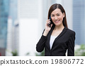 Businesswoman talk to cellphone at outdoor 19806772