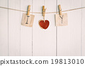 Two blank old paper and red heart hanging.  19813010