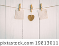 Two blank old paper and brown heart hanging. 19813011