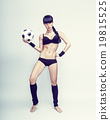 young female holding a soccerball 19815525
