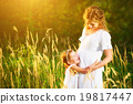happy family,  pregnant mother and daughter little child in summ 19817447