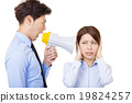 Businessman using megaphone to scream at businesswoman 19824257