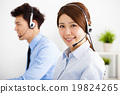 businesswoman and businessman with headset working in office 19824265