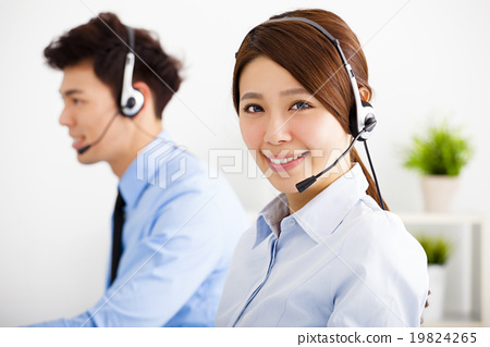 Stock Photo: businesswoman and businessman with headset working in office