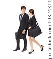 happy businessman and businesswoman walking together 19824311