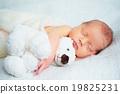 Cute newborn baby sleeps with toy teddy bear 19825231