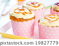 Cupcake with creamy butter on top 19827779