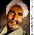 Indigenous Senior Indian Man Looking at the Camera Concept 19842004