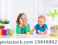 Kids with colorful Easter eggs 19848862