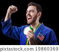 American judoka fighter isolated on black 19860369