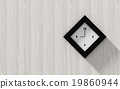 Black clock hanging on the wood wall 19860944