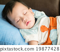 Asian toddler fell into a slumber on bed. The baby sleeping look 19877428