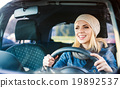 Woman driving a car 19892537