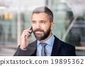 Man with smart phone 19895362