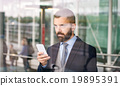 Man with smart phone 19895391