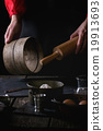 Female hands with wooden rolling-pin and sieve 19913693