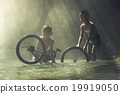 Child playing with bicycle in the creek 19919050