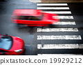 two red cars on the pedestrian crossing 19929212
