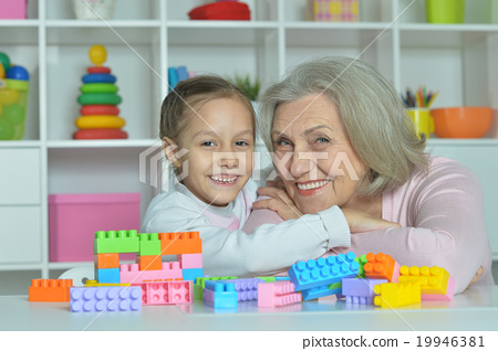 Grandmother with granddaughter playing together 19946381