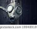 Closeup of a gas mask on a wooden background 19948919
