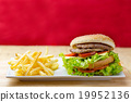 Delicious hamburger and french fries on wood table 19952136