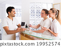 Young man talks with nurses 19952574