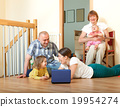 Happy multigenerations family with laptop at home 19954274