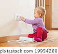 Baby playing with electrical extension 19954280