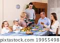Big family celebrating birthday at festive dinner 19955498