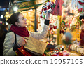 girl shopping at festive fair before Xmas in evening time 19957105
