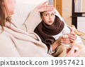 Woman caring for sick daughter 19957421