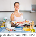 Woman making pizza at home. 19957851