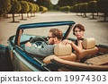 Wealthy couple in a classic convertible 19974303