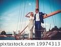 Stylish wealthy couple on a luxury yacht 19974313