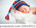 Cute newborn baby in blue knit cap sleeping in basket 20010521
