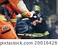 The rescue workers move hurt person with stretcher 20016426