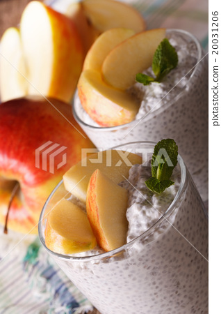 Stock Photo: yogurt with chia seeds and apples in a glass