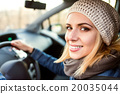 Woman driving a car 20035044
