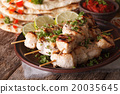 Indian chicken tikka on skewers close-up and naan 20035645