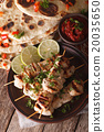 Chicken tikka skewers and naan with chutney 20035650