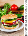 hamburger with fresh vegetables on cutting board 20035996